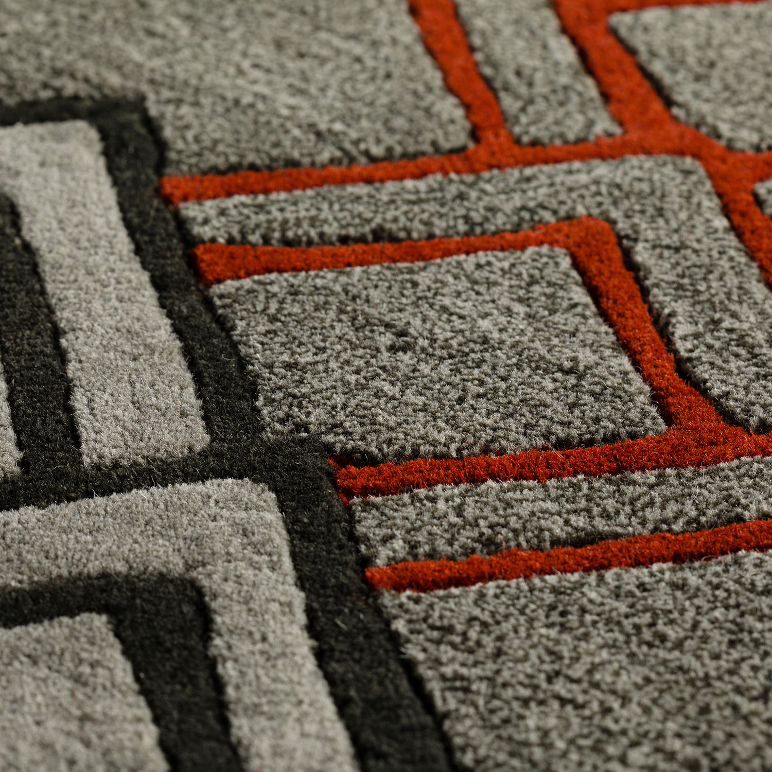 Agra rug closeup of red black and grey rug
